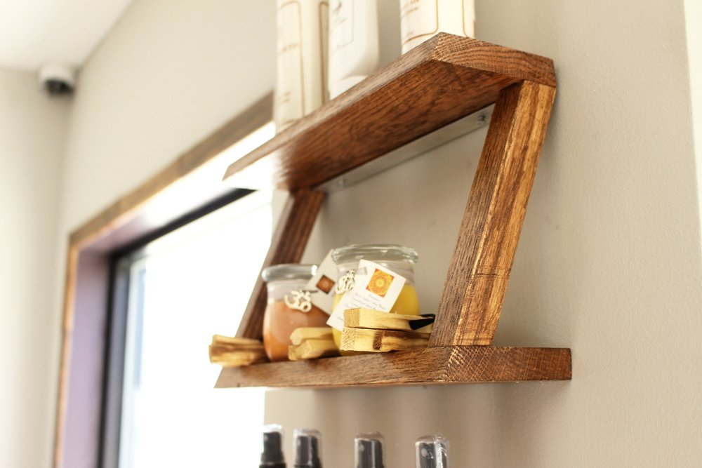 Mossing Studios designed and built these petite 'Z' shelves in a rich honey colored wood to display candles and other soothing products for sale