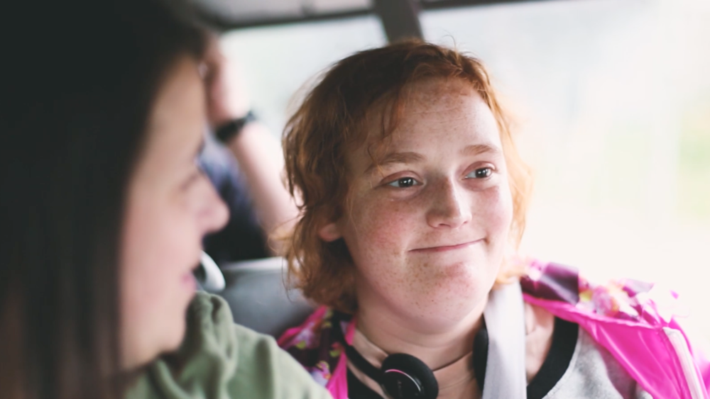 Jamie listens to music and chats with a team member on the way to Meals on Wheels.