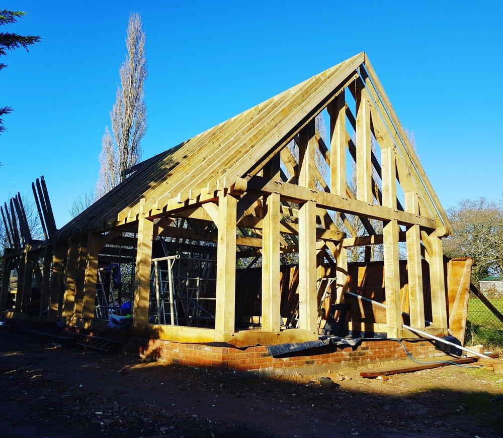 Oak framed garage. 5 bay with 3 oak trusses. We have rebated the end for encapsulated glazing