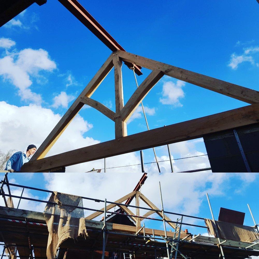 Large king post oak truss being installed