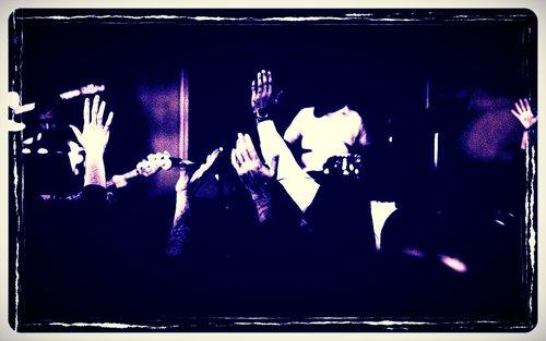 Hands_raised_church_worship_background.jpg
