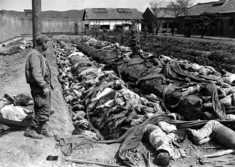 Bodies from a massacre carried out by the US Army's 7th Calvary Division at No Gun Ri, Korea from July 25-29, 1950. Despite widespread agreement among legal scholars the massacre constituted a war crime, no one was ever prosecuted.