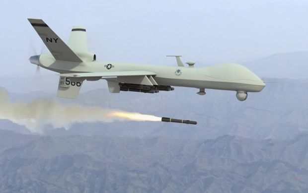 A General Atomics MQ-1 Predator drone fires a missile.