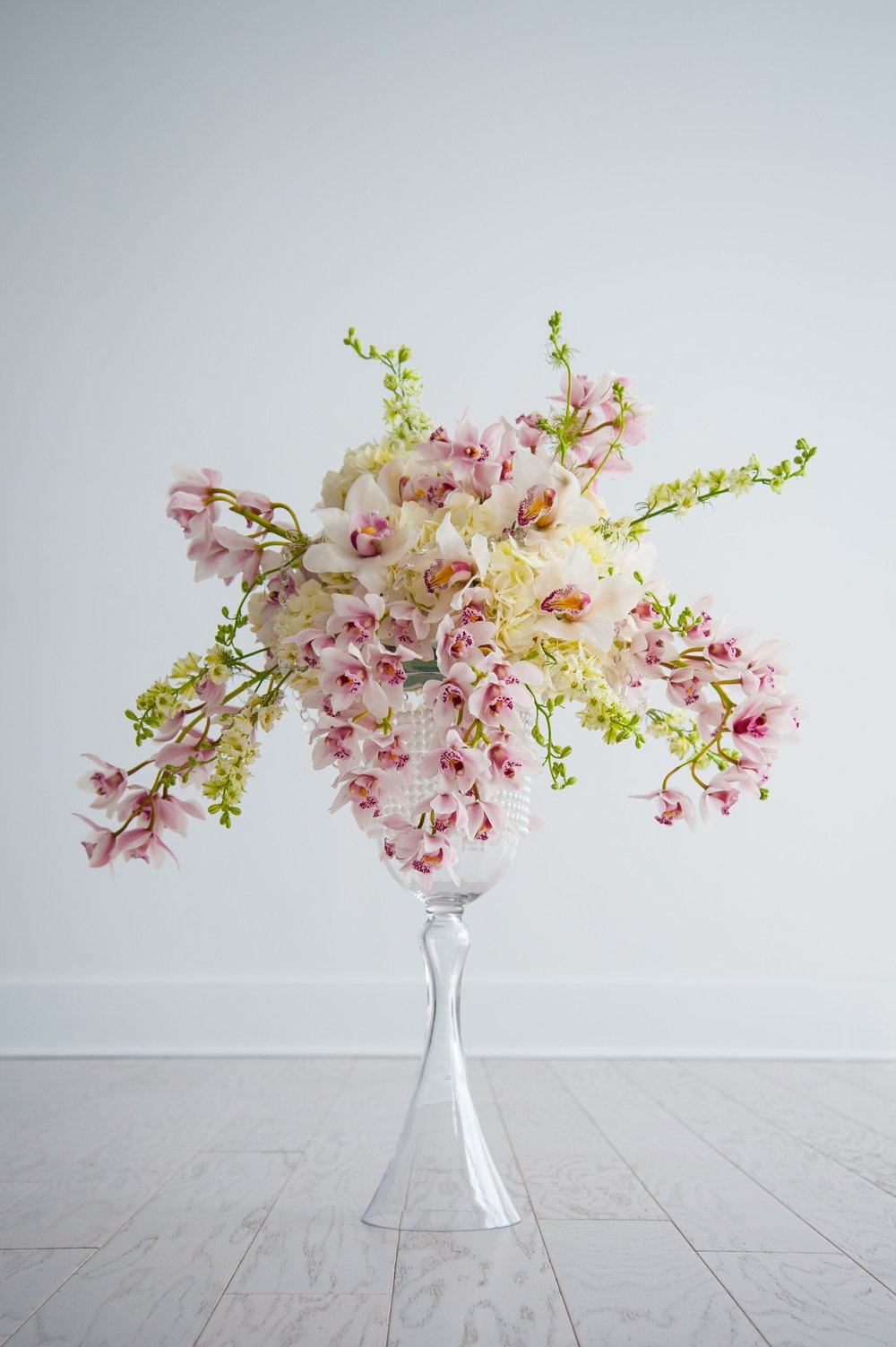 Cerise Floral wedding arrangements centrepieces