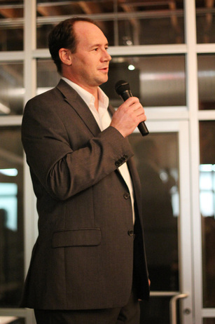 Refugee Services of Texas CEO Aaron Rippenkroeger offers words of encouragement for survivors and thanks to guests of the event.