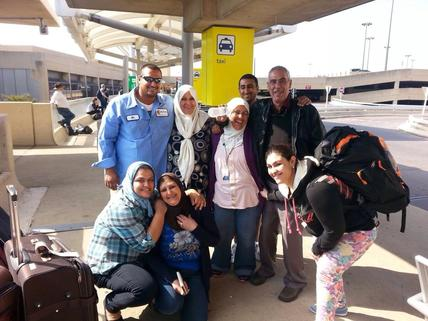 Khalad reuniting with her family at the Dallas-Fort Worth Airport.