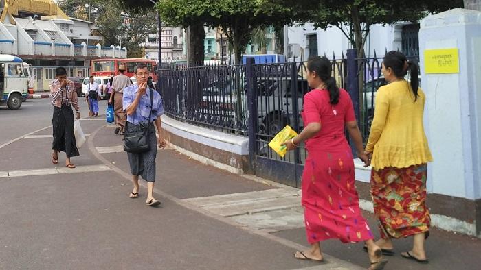 Longyi-clad-Burmese-Locals-men-and-women-both.jpg