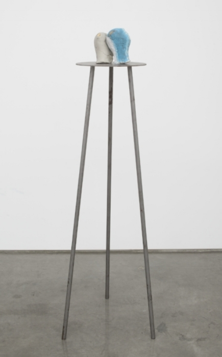 Marisa Merz (Italian, born 1926). Untitled. Undated. Unfired clay, gold leaf, paint, iron tripod. Two heads: 6 5/16 × 6 5/16 × 4 3/4 in. (16 × 16 × 12 cm) each; pedestal: 59 1/16 × 19 11/16 × 19 11/16 in. (150 × 50 × 50 cm) Collection of Anish Kapoor. Courtesy Gladstone Gallery