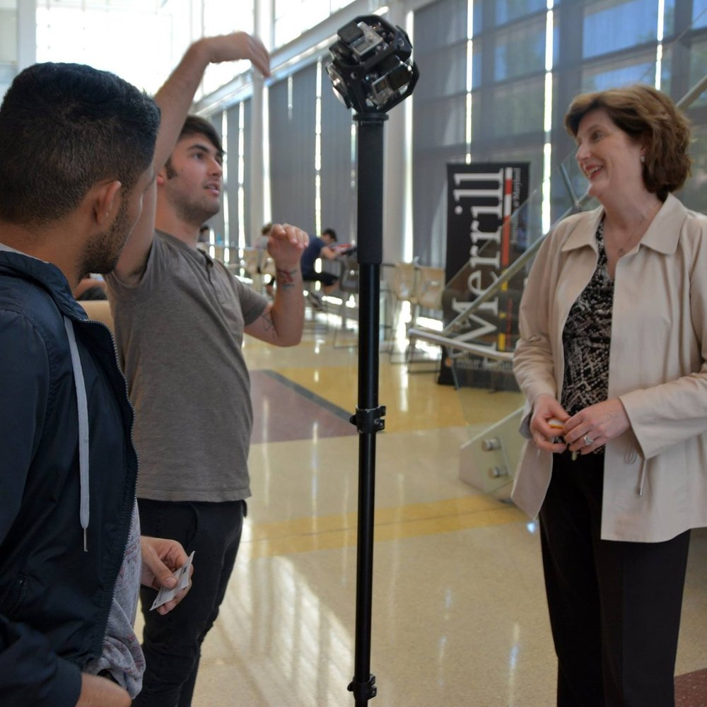 Lucy Dalglish,Dean of the Philip Merrill College of Journalism at the University of Maryland, works with students filming a 360 video.