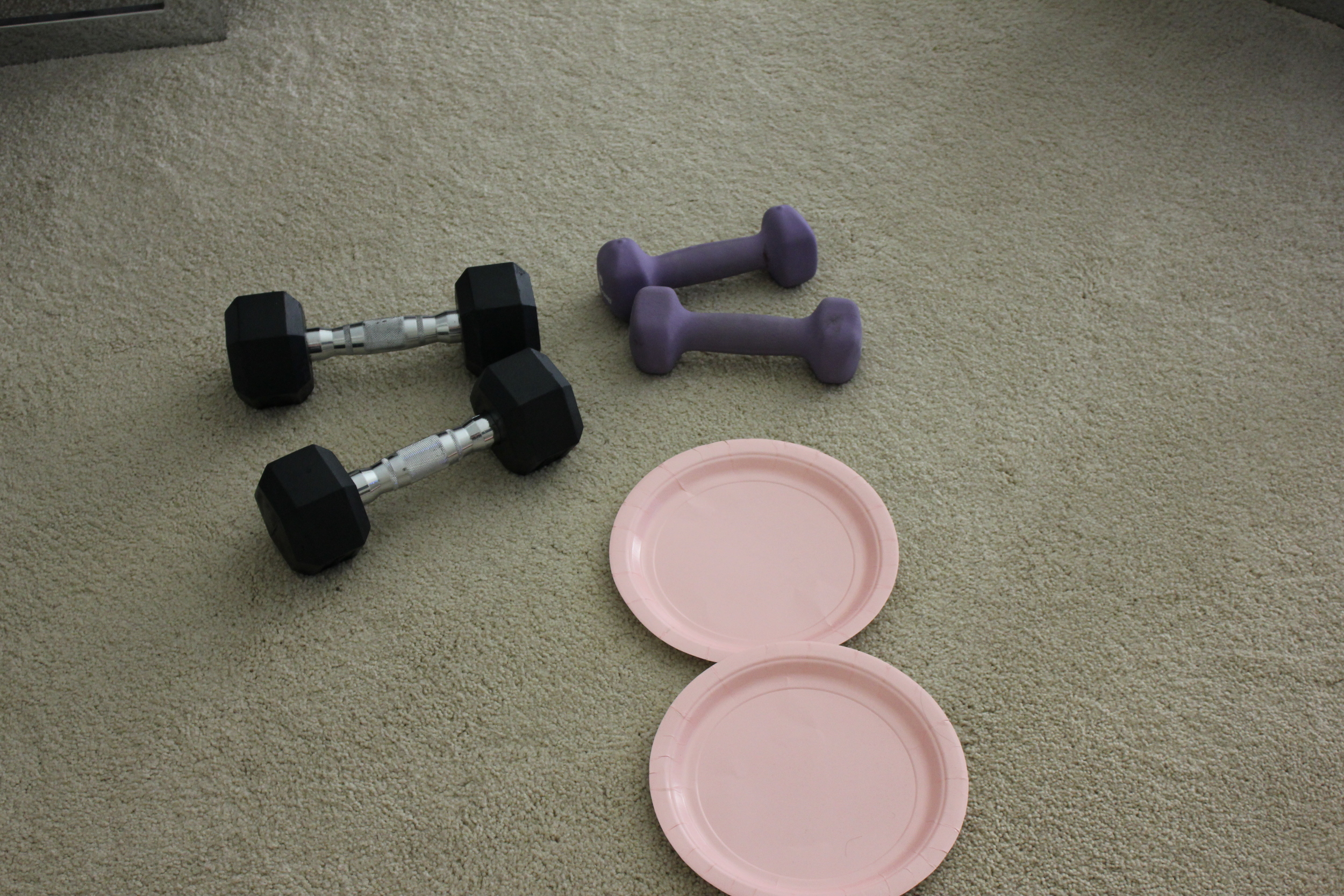 Me getting creative...kidnapping weights from the gym and using paper plates