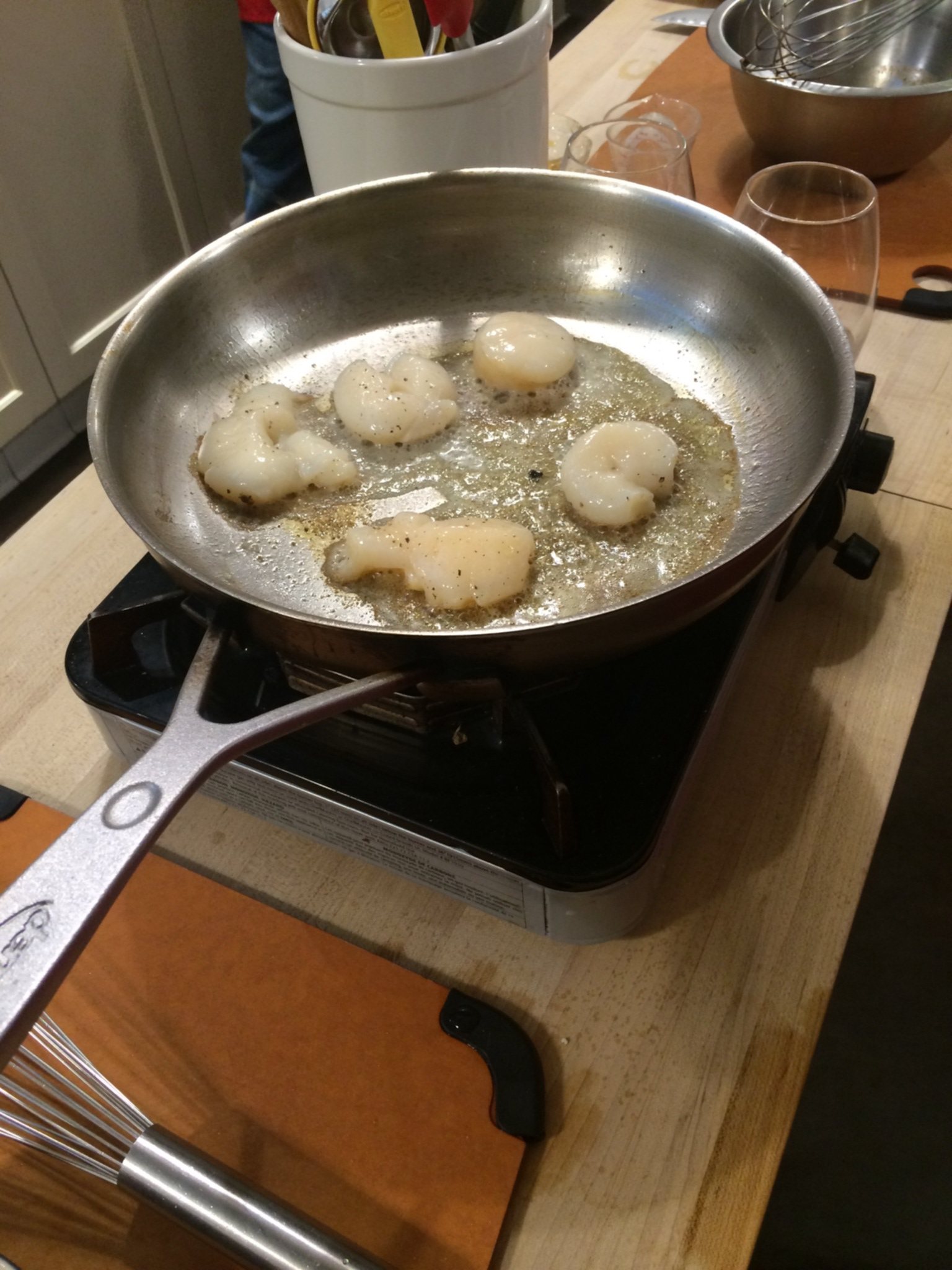 You have to remove the membranes before you cook. Sometimes that makes for a not so round scallop.