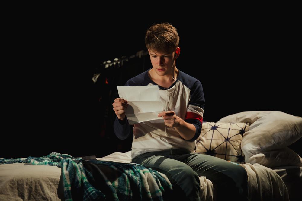 Evan-reading-Letter-2.png