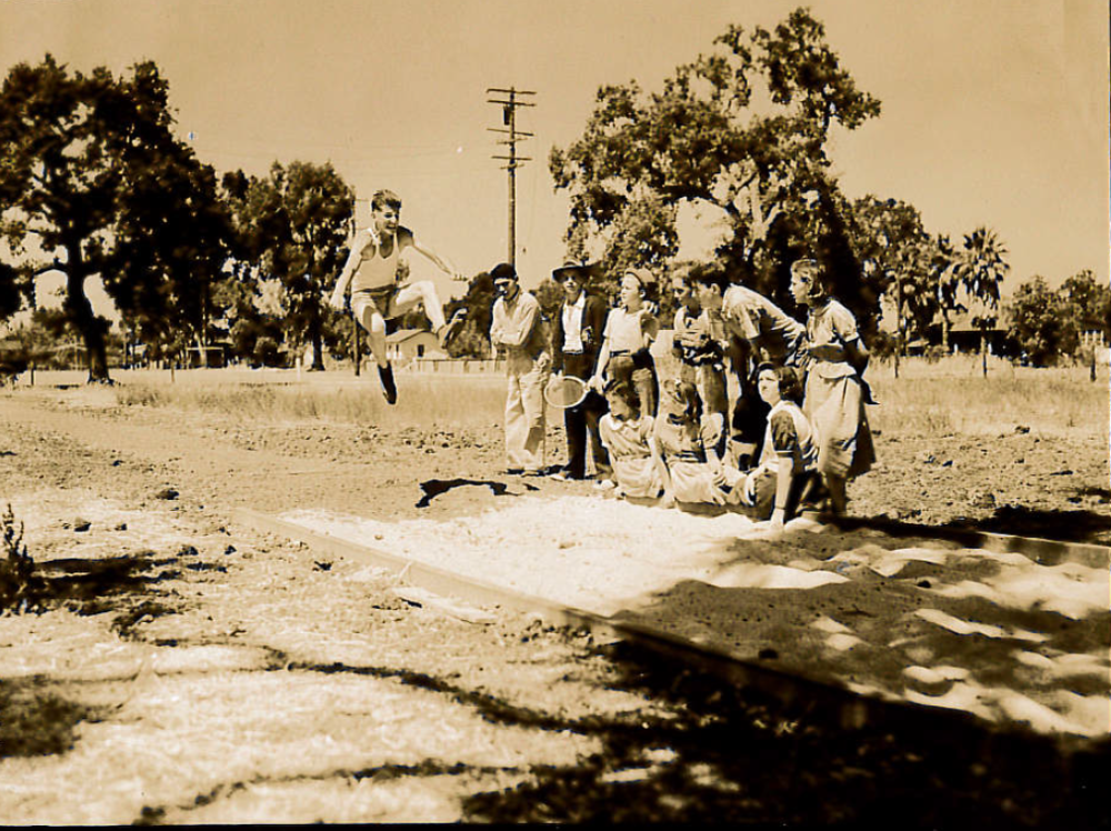 "Image ""longjump"": Vasco Sardi doing the long jump in 1938 at a school playground"