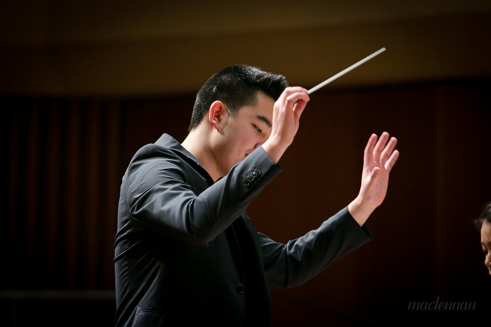 Hunter Chang conducting the rehearsal for the premiere of his Violin Concerto in Pick Staiger Concert Hall