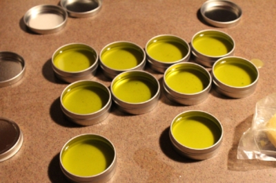 After the oil is strained and beeswax is added it is gently poured into tins. After the liquid becomes hard it is ready for use.