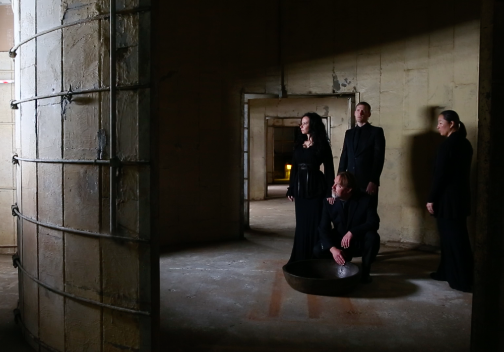 Threshold: a site-specific new music work created for the stunning and sonorous Silos at Sawyer Yards / SITE Gallery. Sunday, April 30, 7pm. L-R: Threshold. L-R: Misha Penton, soprano, concept, director. Chorus: Michael Walsh, Neil Ellis Orts (kneeling), Sherry Cheng,. Photo by Raul Casares