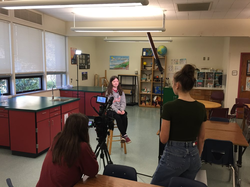 Andie (left) runs camera while Taylor (right) asks this middle schooler interview questions. This kid was a champ. She was asked to go on camera only moments before and completely nailed it (she even said she wants to be a filmmaker!).