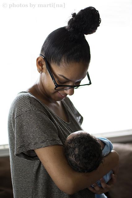Mother holding her newborn baby boy, photo by Martina