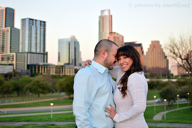 Engaged couple standing in front of downtown Austin, Texas