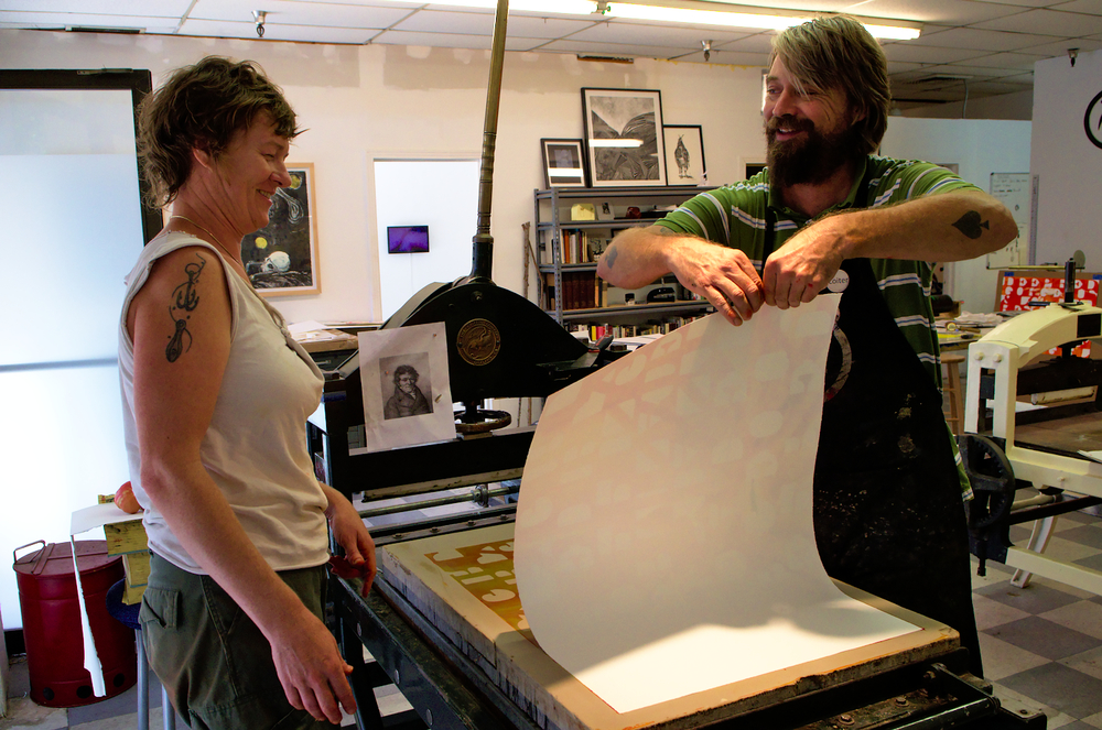 "Richard pursues the same accompanying philosophy, seeking ""to support artists' sustainability, collaboration and experimentation"", here assisting Jessica Rath on a complex lithography project. ""The pressure is under the press, not on your shoulders"" reassures Richard."