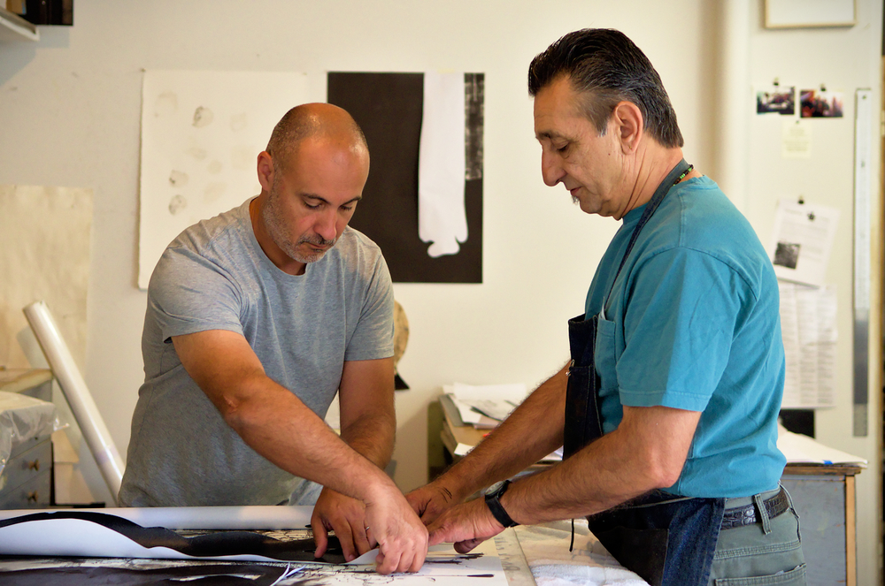 John, printmaster, closely collaborates with the artists he assists. Here with Stas Orlovski (left), he gives continuous advice and feedback during the creative process of a monotype edition.