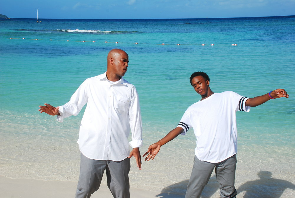 Father and son matrix moves against a backdrop of powdery sand and clear blue water. - Montego Bay, Jamaica
