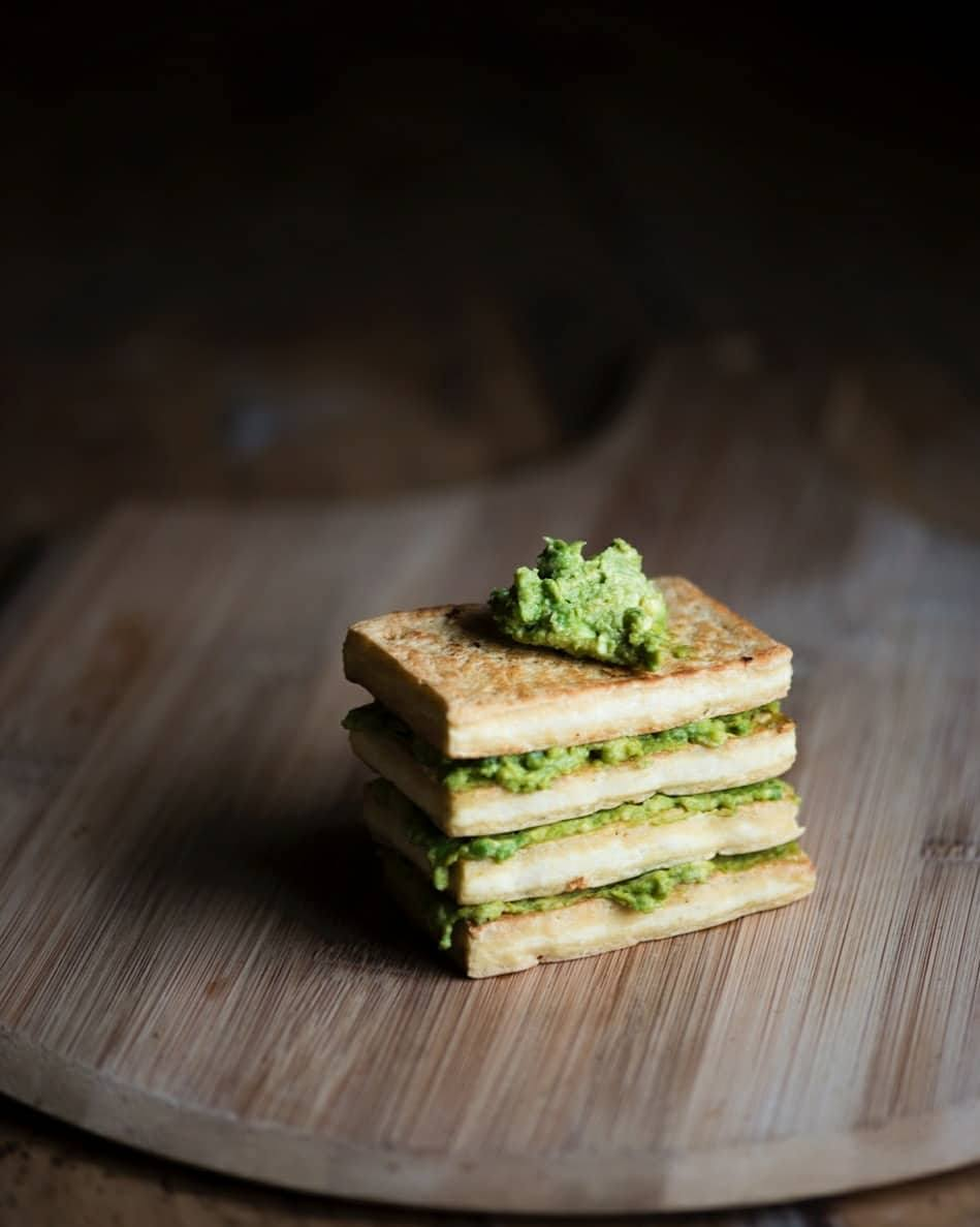 Tofu + avocado stack. One of the easiest, yummiest and most nutritional snacks ever! Sliced firm organic tofu pan fried in a little bit of rice bran oil. Avocado smashed with hemp seeds, nutritional yeast and pink salt. Layer them together and ta-dah!