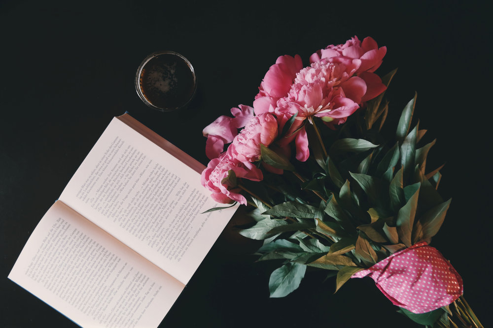 book and pink flowers