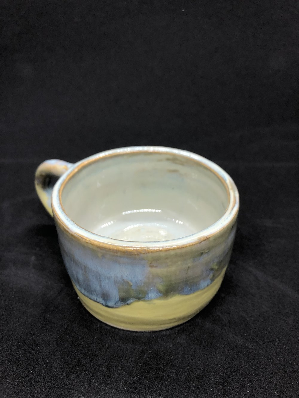 Thrown cup with yellow glaze