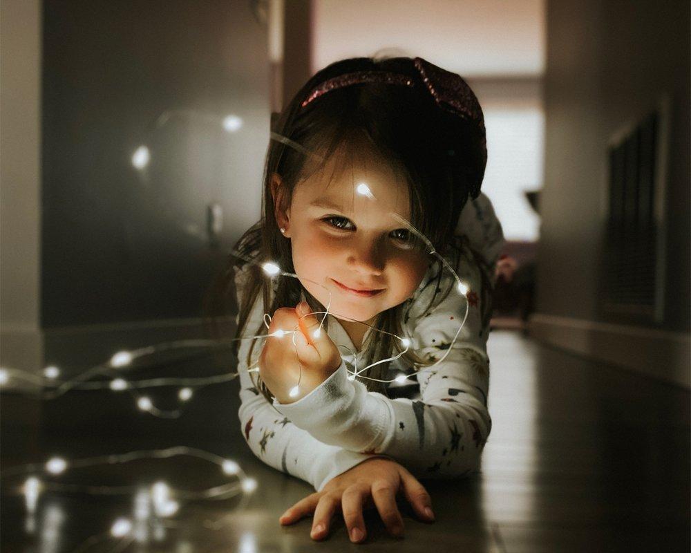 Shot-on-iPhone-holiday-Little-girl-with-string-lights-12192018_big.jpg.medium_2x.jpg