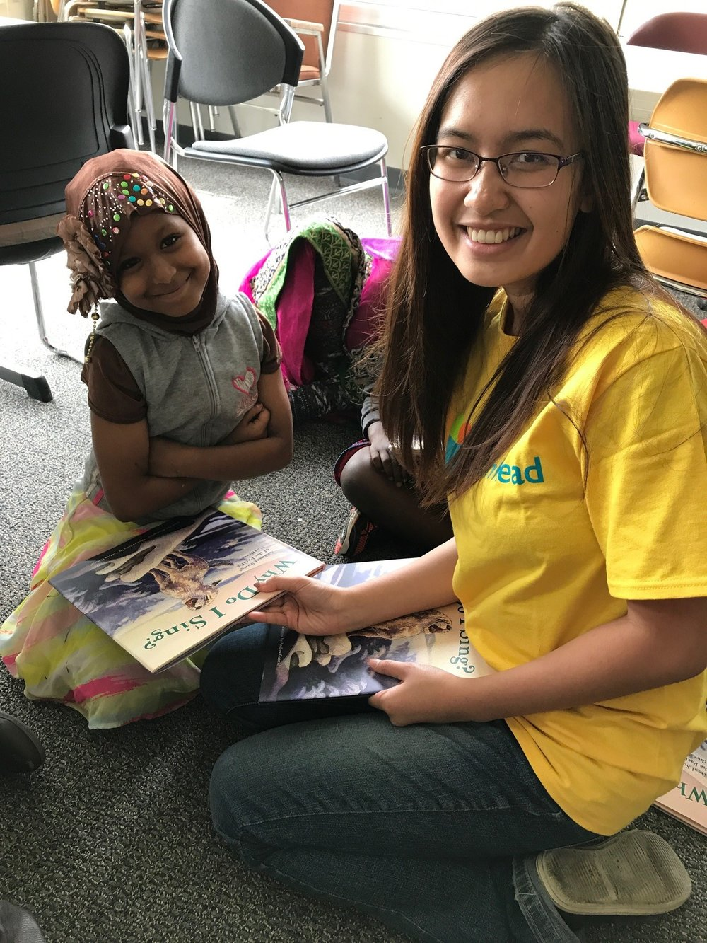 TIPS Intern Jessica sharing a book with a Team Read student