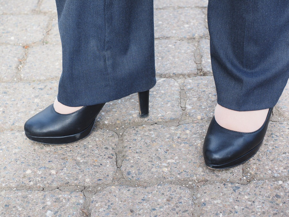 High heeled shoes can give more options with trouser length and still keep a professional style.