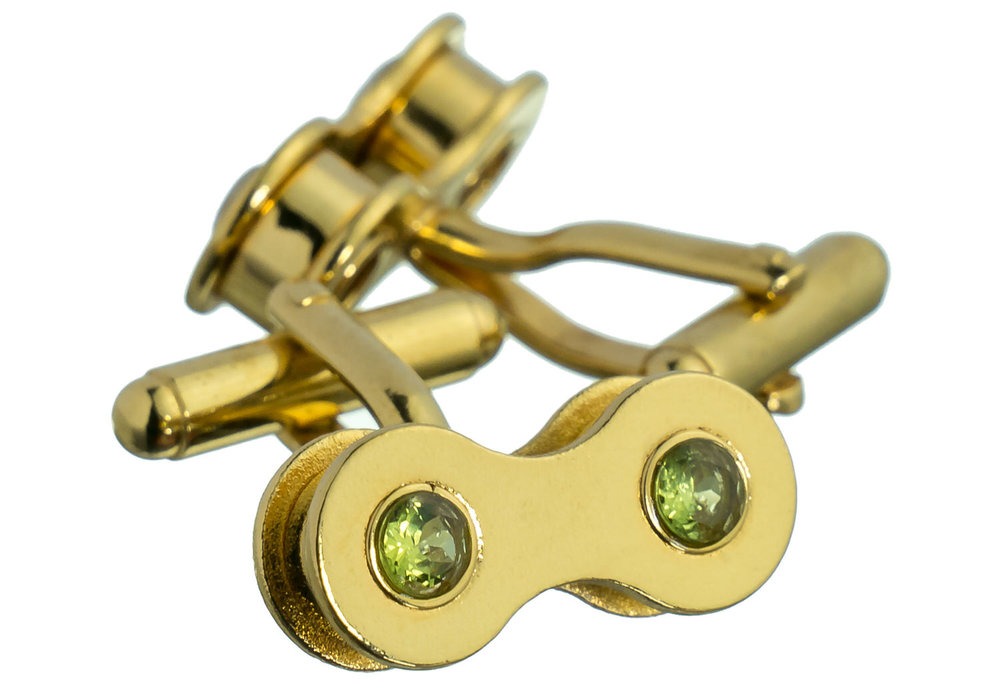 A pair of gold and peridot cufflinks