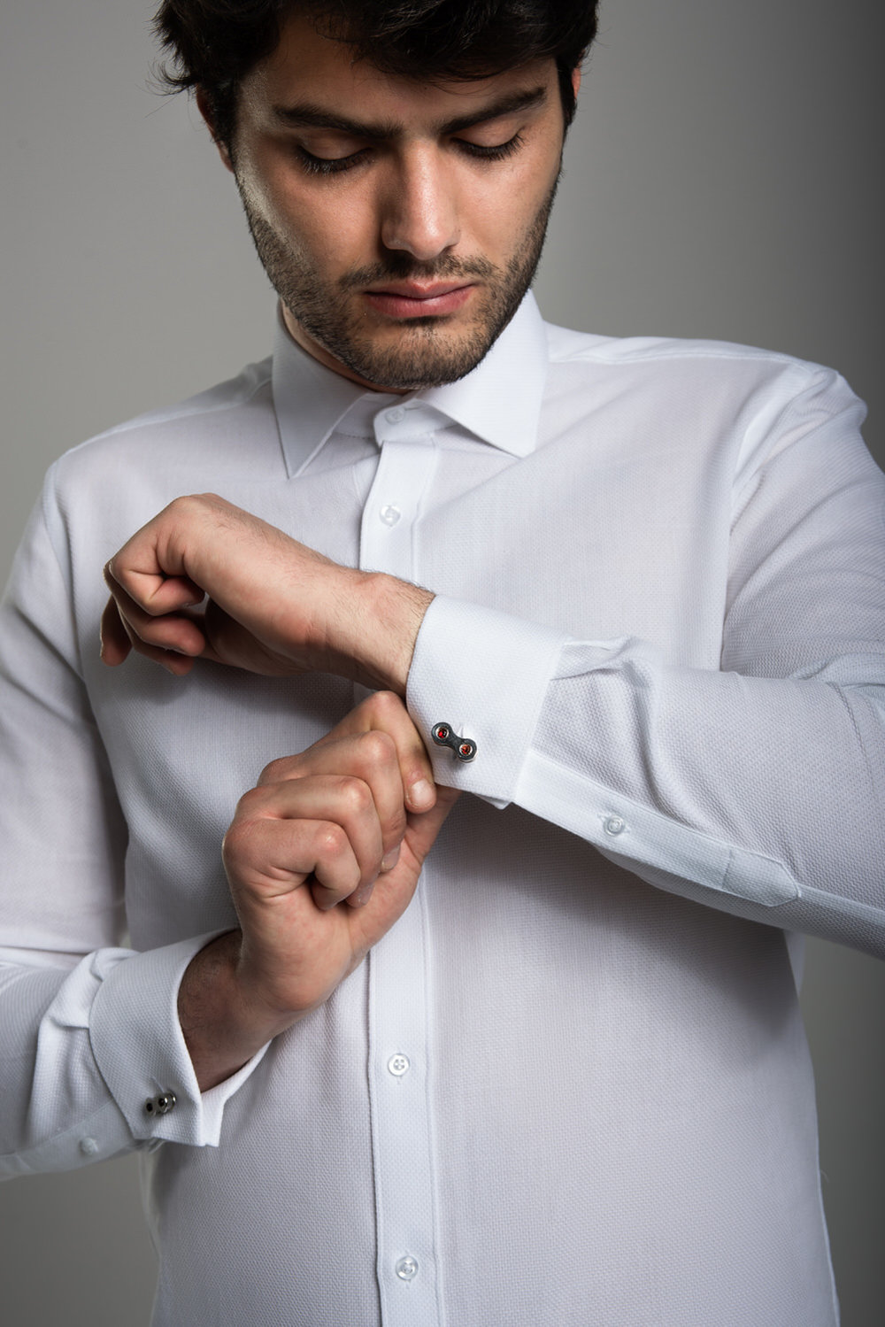 A mens cufflink shirt. Notice the structured collar and clean lines.