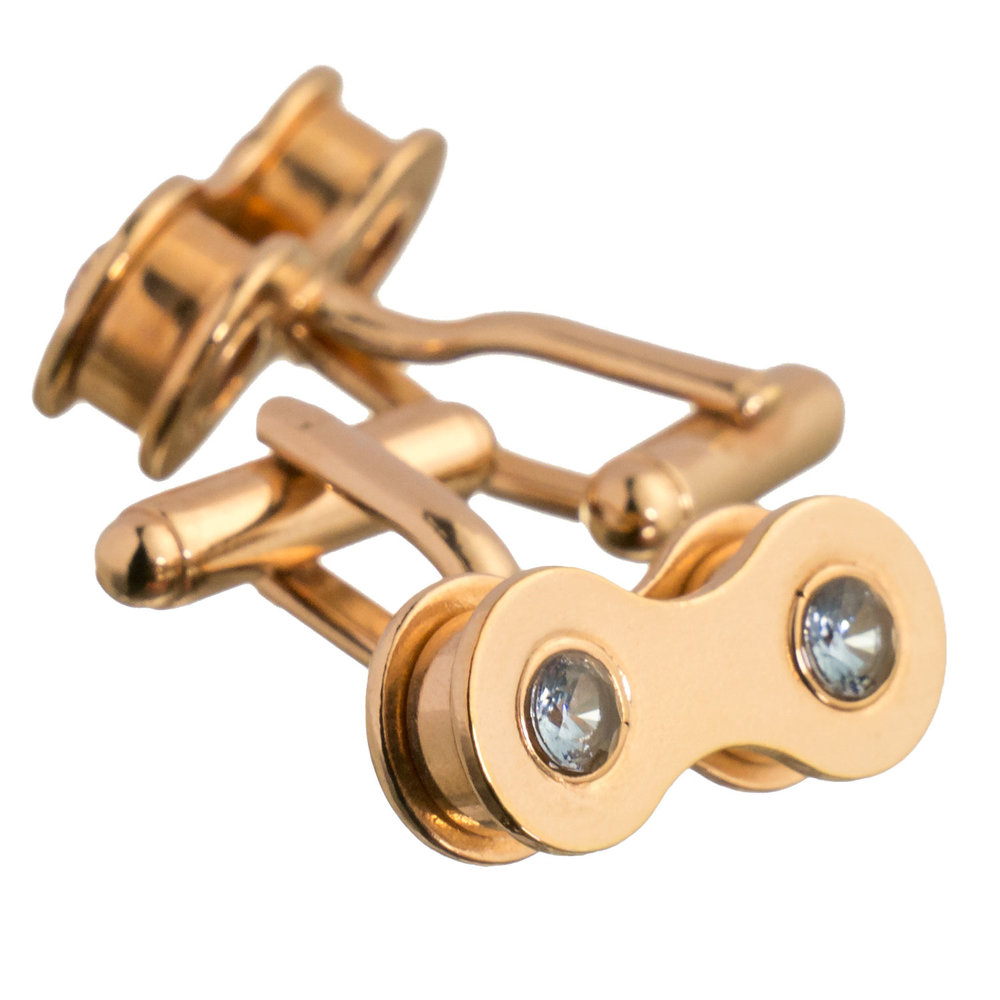 Rose gold bike chain cufflinks with aquamarine