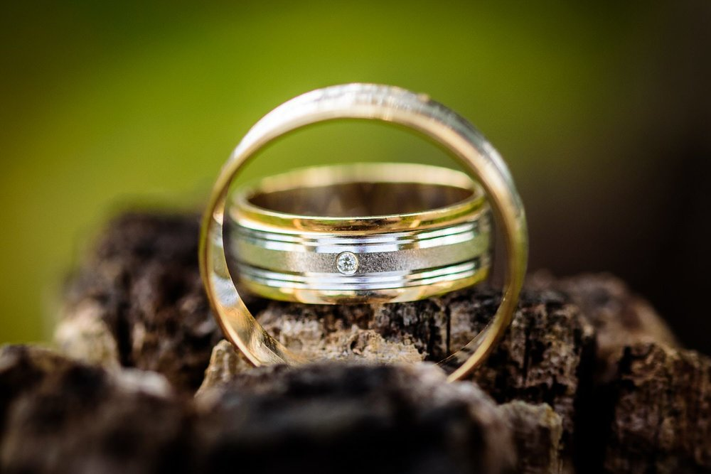 Men's diamond ring with a small diamond.