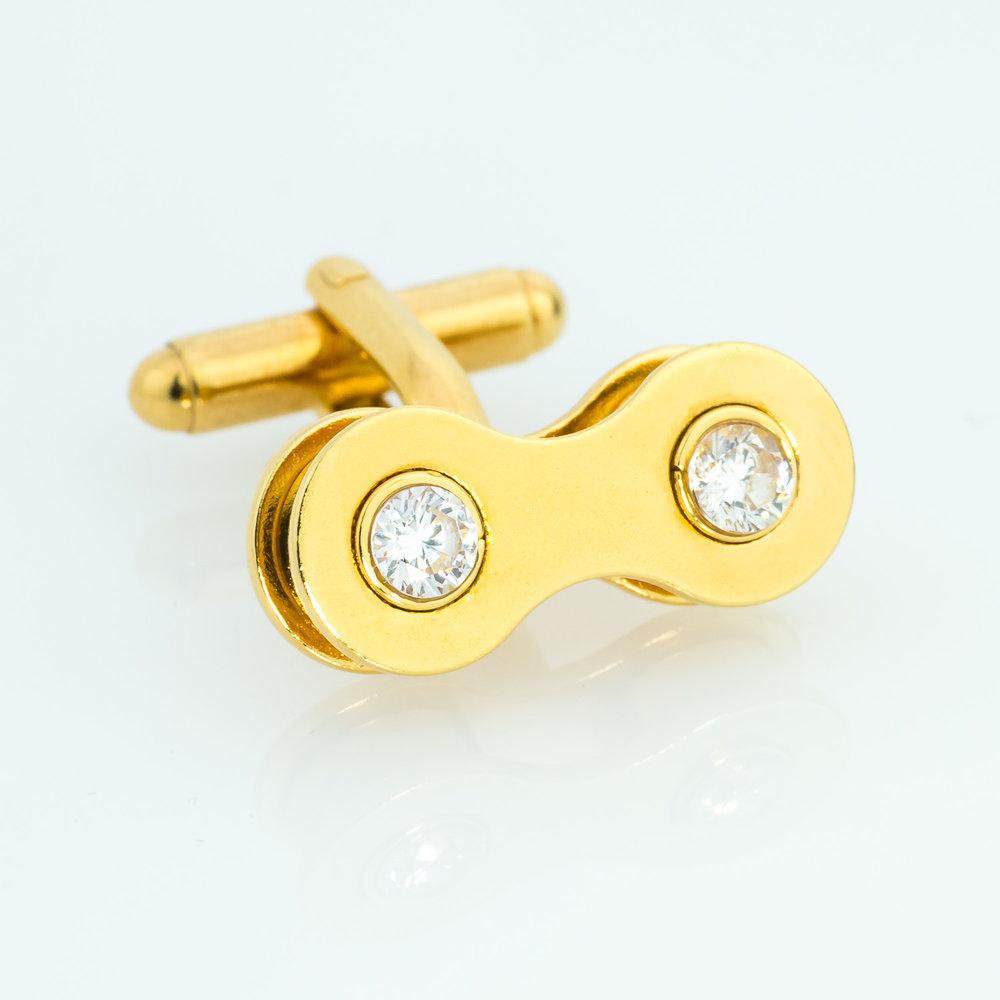 Gold and created diamond cufflinks. Made from bike chain.