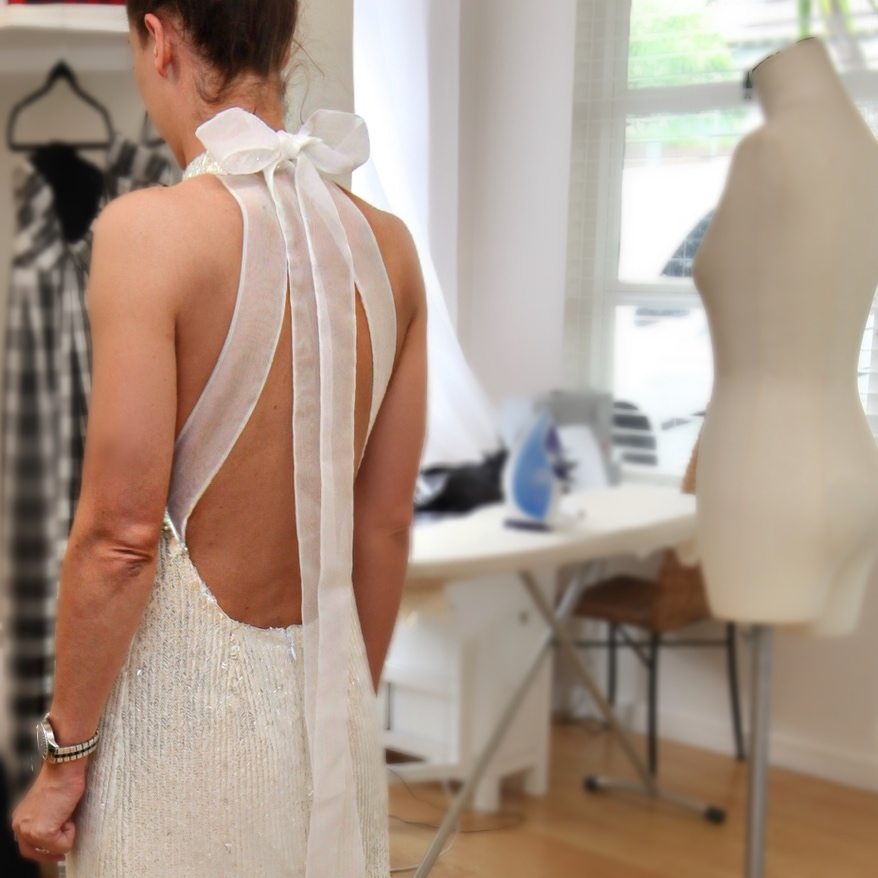 Halter neck going away bridal gown strap placement