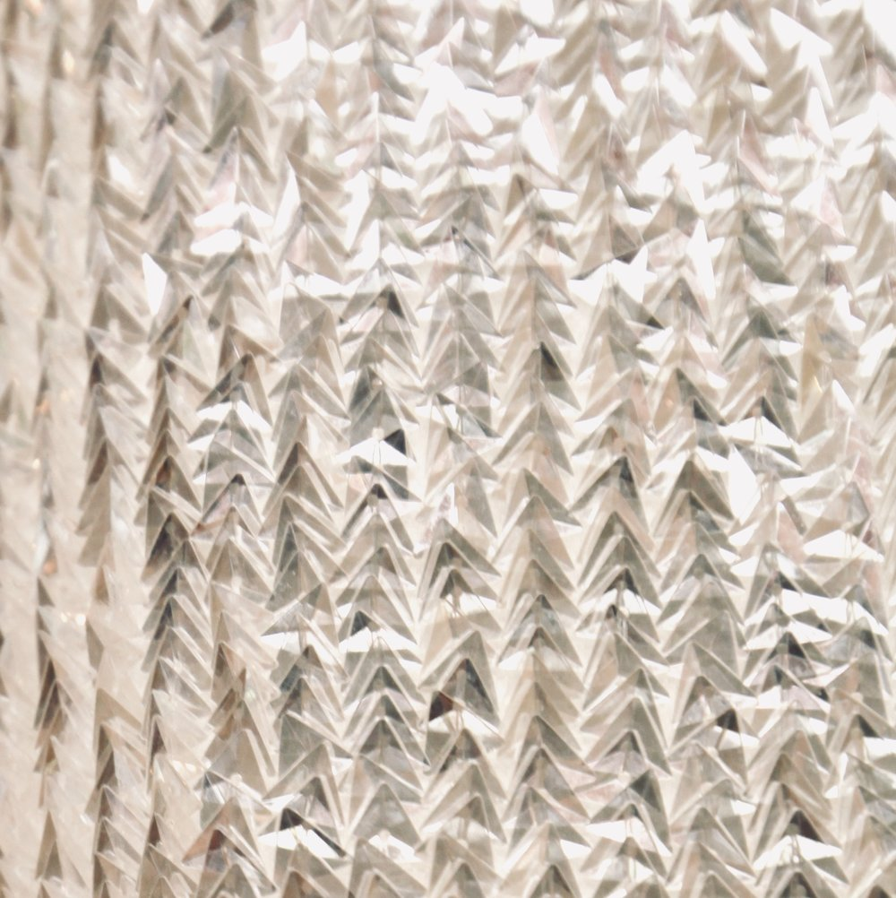 Triangular sequin fabric for wedding gown