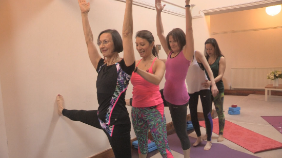 yoga students working with props on a yoga workshop