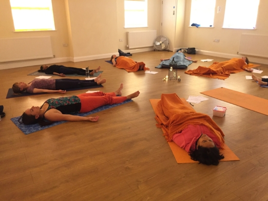 relaxation techniques during a yoga workshop