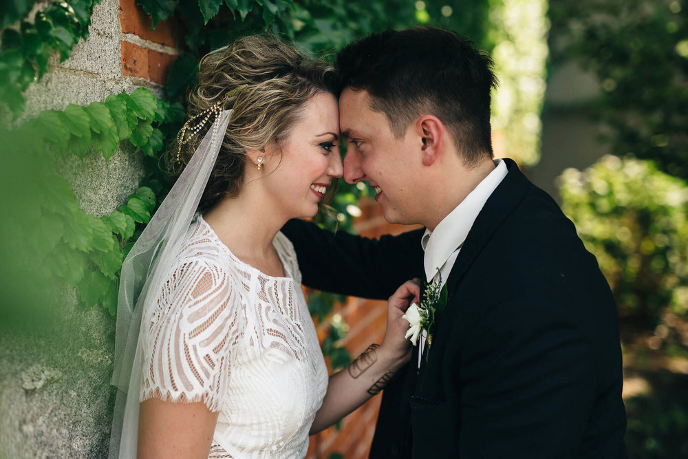 KRISTINE + RYAN - Swatch Studios captured this bride and groom's industrial + emerald inspired wedding - with a nod to their favorite band. Take a peek at this downtown Toledo wedding.
