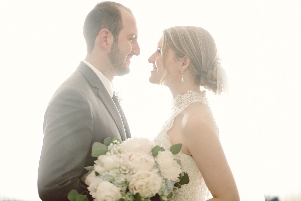 Eve + David - The bride and groom were inspired by the vision of an ethereal spring wedding with a delicate pastel color palette, soft florals, and bountiful greenery in Archbold, Ohio