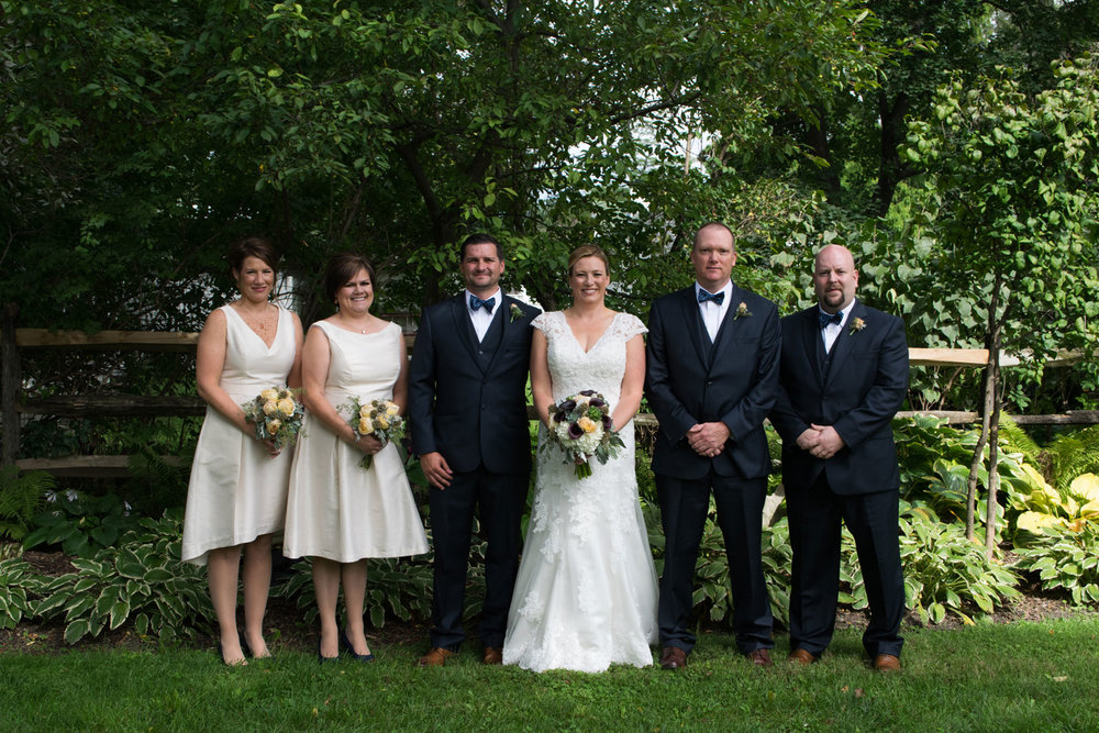 Jennifer + Brian - Carranor Hunt and Polo Club is a hidden gem in Perrysburg, Ohio and was the reception venue for Jennifer and Brian's September wedding. We love her bouquet with touches of succulents and their baby basil favors.