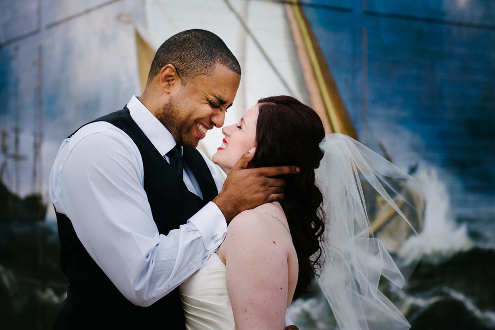 Erica + Justin - The story of how they met, fell in love, and their proposal will bring a tear to your eye. Visit their wedding day at Registry Bistro and see how it was a true celebration of their love.
