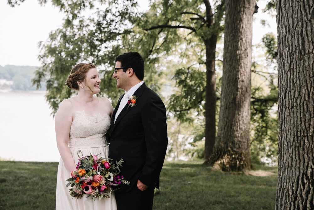 Laura + Avi - Gray skies couldn't keep these two from saying their I do's overlooking the Maumee River.
