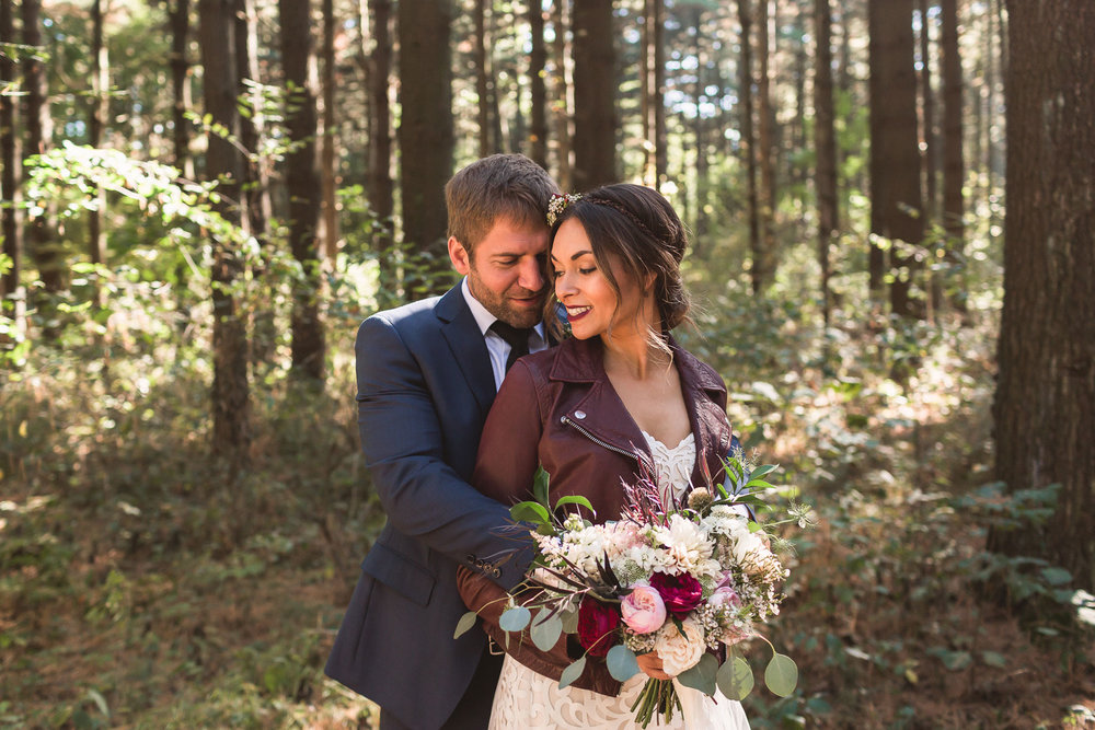Jenna + Zach - From Jenna's leather lace wedding gown, to the rustic farm tables, vintage china, and blushing garden roses no detail was missed for this rustic, chic wedding hosted at The Stables.
