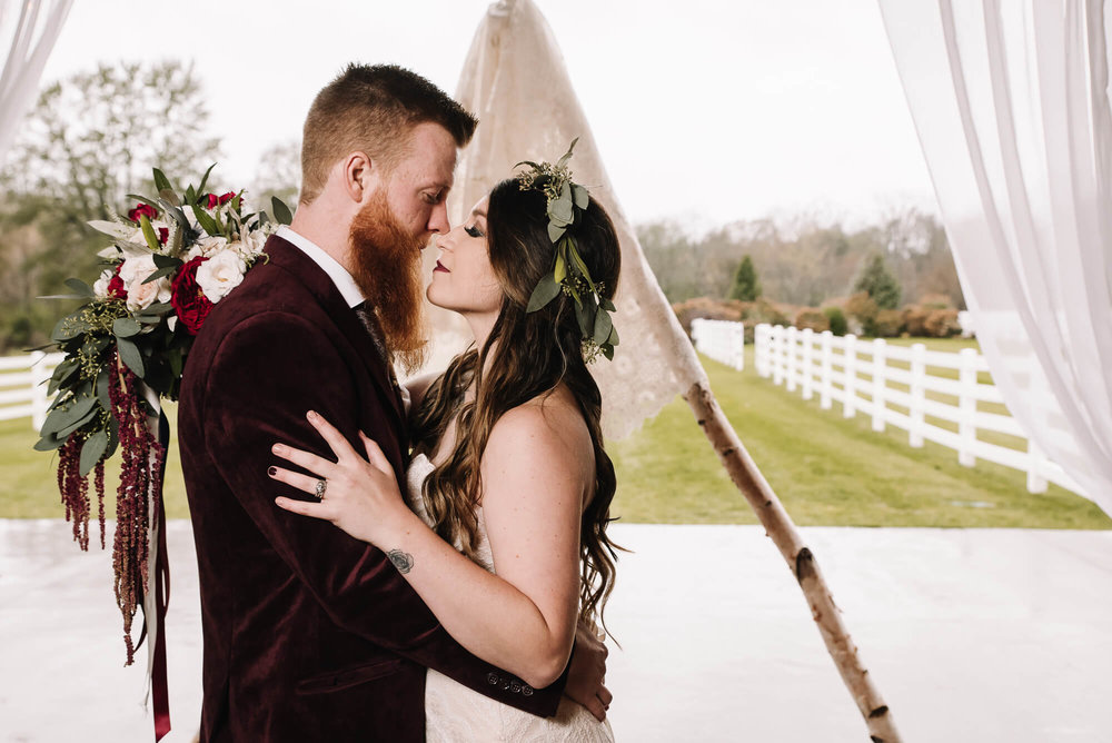 Paige + Matthew - We love a vintage bohemian style and this wedding has it all. From their burgundy velvet jackets to the vintage china plates and the custom built teepee this couple did not disappoint.