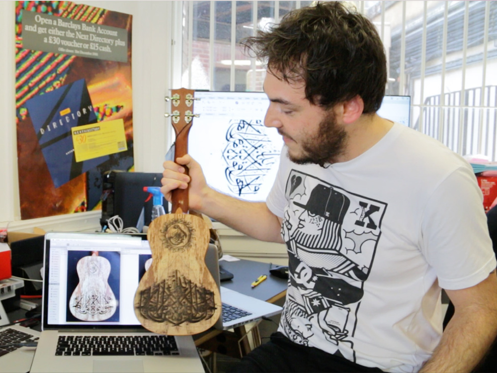 tom lamont with arabic etched ukelele for Tabi Stew. Made by Burntaxe brighton