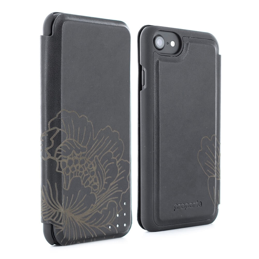 Burntaxe Proporta leather Laser etched iPhone8 iphone7 iphone8 plus iphone7 plus folio Phone case in Black Flower design limited edition Our commuter case in a distinguished leather effect offers 9-5 style and sophistication with its premium build and corresponding card slot feature. Carry your business or payment card with you whilst you're on the move and take advantage of the slim build of the slip-in card construction. Guaranteed to not add excess bulk, this market-leading design ensures the folio's magnetic flip-back cover will always sit flush. The iconic folio case is complete with the design principles we're renowned for, from our soft-feel embedded back shell with ergonomic inserts to our suede-feel lining and hand-crimped edges. An additional six punctures to the front cover offer a glimpse of the robust aluminium which lines the cover and protects your iPhone from damage.